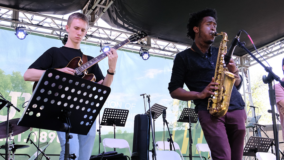 Ethan Ditthardt, guitar, Patrick Hill, saxophone. Denton Arts & Jazz Festival 2019. Photo by Christopher Walker.