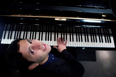 Christian Valdes playing the piano