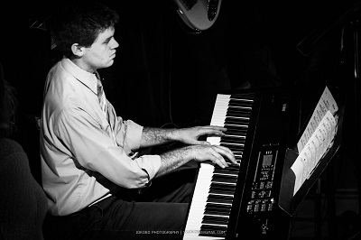Greg Santa Croce playing the piano